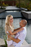 Happy couple holding each other by the pool Royalty Free Stock Images