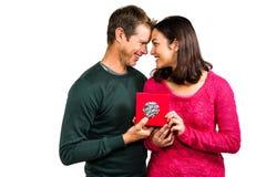 Happy couple holding gift box Stock Photography