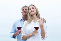 Happy couple holding a glass of red wine Royalty Free Stock Images