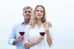 Happy couple holding a glass of red wine Royalty Free Stock Photos