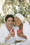 Happy Couple Holding Glasses Of Strawberry Juice Royalty Free Stock Photo