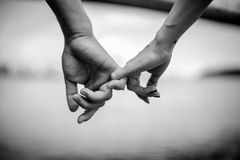 Happy couple holding hands. Black and white stock photos