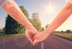 Happy couple holding hands close up Stock Images