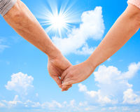 Happy couple holding hands close up Stock Image
