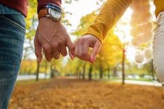 Happy couple holding hands closeup royalty free stock photos