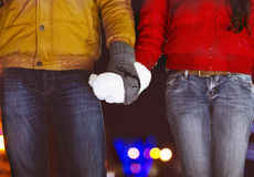 Happy couple holding hands in knitted mittens Royalty Free Stock Photo