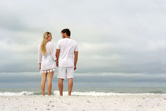 Happy Couple Holding Hands on Ocean Shore on Beach Stock Photos