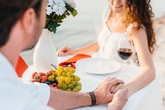 Happy couple holding hands after propose. In romantic date stock image