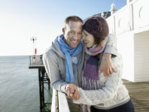 Happy Couple Holding Hands By Sea On Pier Stock Images