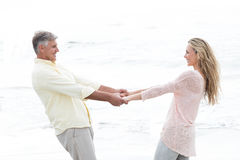 Happy couple holding hands and smiling at each other Stock Image