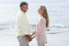Happy couple holding hands and smiling at each other Royalty Free Stock Photography