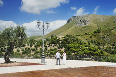 Happy couple holding hands in Sperlonga, Italy Stock Images
