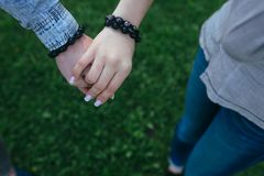Happy couple holding hands Royalty Free Stock Image