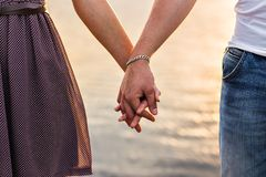 Happy couple holding hands. In the sunset Royalty Free Stock Photography