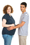 Happy couple holding hands on tummy Stock Photo