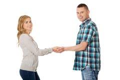 Happy couple holding hands Stock Photos