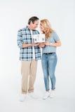 Happy couple holding house model on white Stock Images