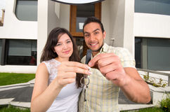 Happy couple holding key to their new house Royalty Free Stock Photography