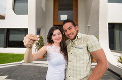 Happy couple holding key to their new house Royalty Free Stock Image