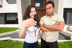 Happy couple holding key to their new house Royalty Free Stock Photo
