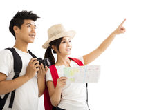 Happy couple holding map and camera royalty free stock photo