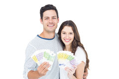 Happy couple holding money Royalty Free Stock Photography