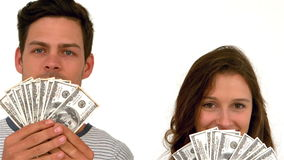 Happy couple holding money. On white screen stock footage