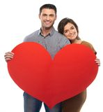 Happy couple holding paper heart Stock Photos