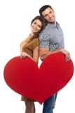 Happy couple holding paper heart Royalty Free Stock Photo