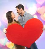 Happy couple holding paper heart Stock Images