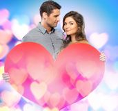 Happy couple  holding paper heart Royalty Free Stock Photography