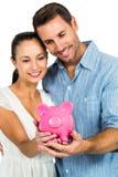 Happy couple holding piggybank Stock Photo