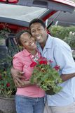Happy Couple Holding Potted Plant Royalty Free Stock Photo