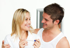 Happy couple holding a pregnant test Stock Images