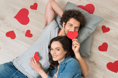 Happy Couple Holding Red Hearts Stock Image