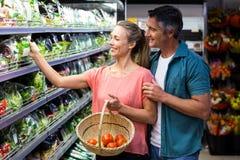 Happy couple holding salad Stock Photos