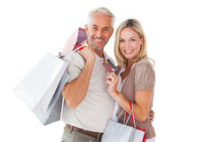 Happy couple holding shopping bags and credit card Royalty Free Stock Image
