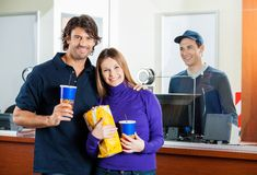 Happy Couple Holding Snacks With Seller At Box Stock Photography