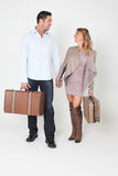 Happy Couple Holding Suitcases Stock Images