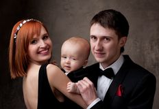 Happy couple holding their baby boy Royalty Free Stock Photo