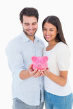 Happy couple holding their piggy bank Royalty Free Stock Photo