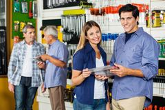 Happy Couple Holding Tool Set In Hardware Store Royalty Free Stock Photo