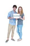 Happy couple holding a volunteer note Royalty Free Stock Photo