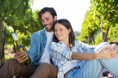 Happy couple holding wine bottle Royalty Free Stock Photography