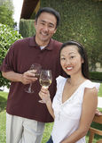 Happy Couple Holding Wine Glasses Stock Photography