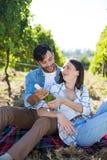 Happy couple holding winebottle Royalty Free Stock Photo