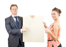 Happy couple holds blank canvas Stock Image