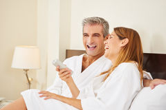 Happy couple during holiday in hotel. Happy couple laughing during holiday stay in hotel room Stock Photo