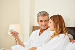 Happy couple during holiday in hotel. Room watching TV Royalty Free Stock Image