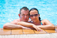 Happy couple on holidays. In tropical swimming pool Stock Photography